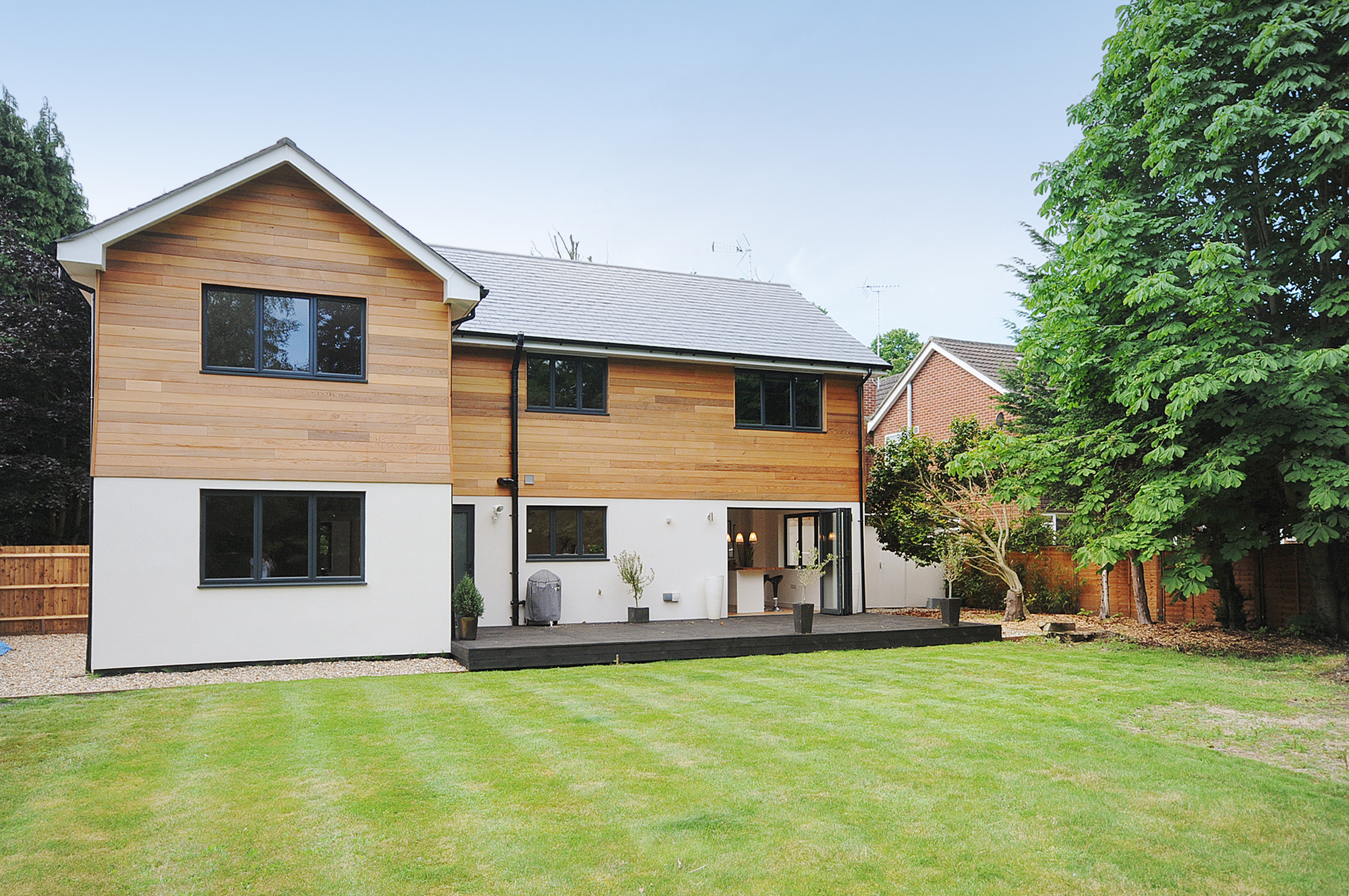 Conversion of bungalow to two storey house hampshire for Modern house designs uk